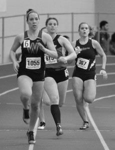 Junior Melissa Cooley (right) beat her own and Lasell's record in the 400 meter race at BU's Invitational on February 17. (Photo by Tom Horak)