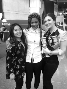 Students Jamie Tran (left) and Michaela Kotob (right) pose with Lasell College alumn and two-time Project Runway competitor, Sonjia Williams.  (Photo courtesy of Fashion Connection Club)