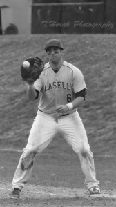 Billy Uberti playing during his last season as a member of the baseball team.  He recently became an assistant coach for the team after graduation.  (Photo by Tom Horak)