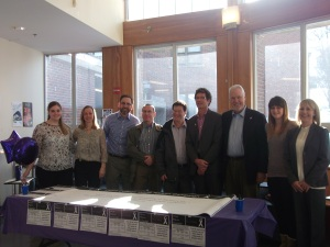 Photo by Kayli Hertel Students and faculty stand together after the first signings of the pledge.