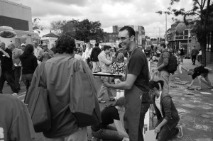 A street vendor interacts with crowds of Bostonians looking for a good time. The Allston Village Fair will be hosted on October 4, from 12 to 6 p.m. Photo courtesy of Allstonvillagefair.com