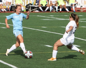 Women's soccer is hoping to win GNAC for the sixth consecutive year. Pictured left is Meg Cullen. Photo by Tom Horak