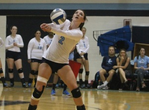 Senior Taylor Hansen focuses in on passing the ball. The team is working hard to improve this season. Photo by Tom Horak