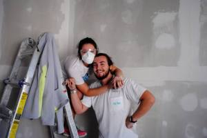 Photo courtesy of Lasell Says Thank You Junior J.R. Costello and senior Morgan Nash take a break while helping to rebuild a house.