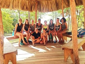 Photo courtesy of Raquel Barnes  Students pose together after doing service in Lasell's last June to Belize.