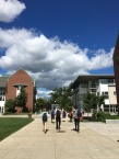 Students walk to and from class as clouds hang over the campus center. Photo by Ryan Fitzgerald.