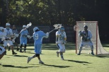 Senior Anthony Saitta rips a shot on the alumni lacrosse team during the annual game Saturday. Photo by Jackie Colombie.