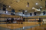 Women's volleyball lines up for the national anthem in game one of their doubleheader Saturday. Photo by Jackie Colombie.