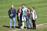 Captain of the men's soccer team John Sutton stands with his family as the lone senior on Senior Day. Photo by Jackie Colombie.