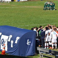 The Lasers prepare to take on Mount Ida on Taylor Field. Photo by Jackie Colombie.