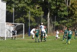 Sophomore Carter Migre heads a ball toward the goal in the team's 2-1 loss to Mount Ida. Photo by Jackie Colombie.