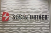 This banner greets visitors to the offices of the Social Driver PR firm. The simplicity of the sign reflects the companies simple mission of creating social progress through the use of technology. Photo by Spencer Kosior.