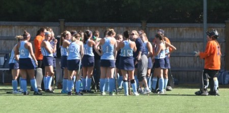 Denise Landry (right) stands along with the rest of the Laser field hockey team during a before a game. Photo by Jackie Colombie