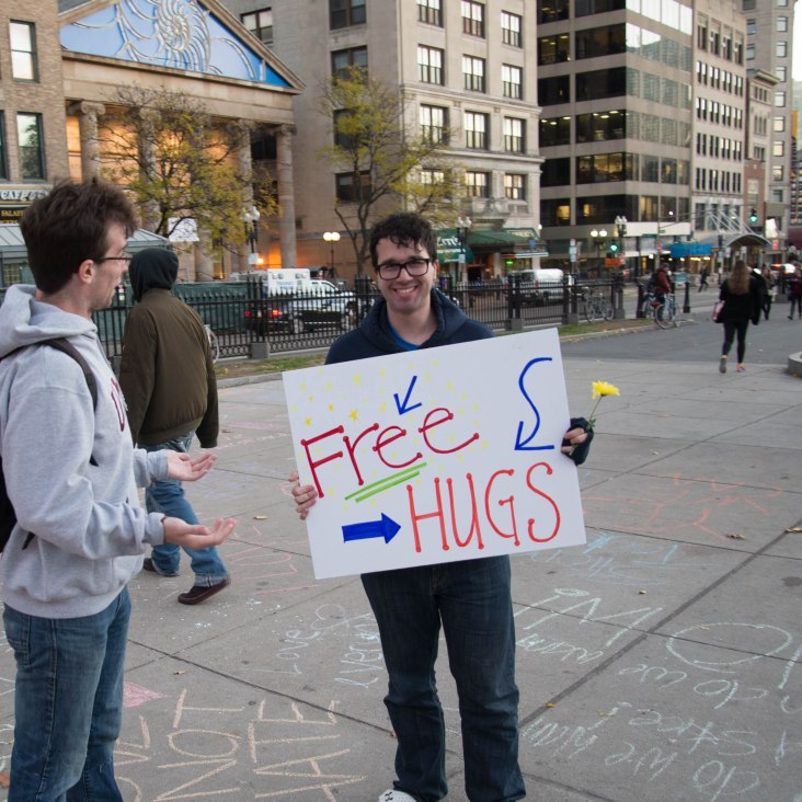 Protestors offered free hugs to people walking through Boston Common during a peaceful protest against this year's election on Nov 11.