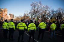 State police monitor the scene as thousands march the streets in Boston. (Photo by Michael Bueno)