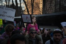 "A young girl holds a sign that says ""Girl Power."" (Photo by Michael Bueno)"