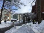 Workers shovel snow outside MCclelland Hall and West Hall.