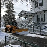 Snow plows worked constantly throughout the weekend to clear campus.