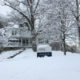 The sign of Karandon House was nearly covered from snowfall.