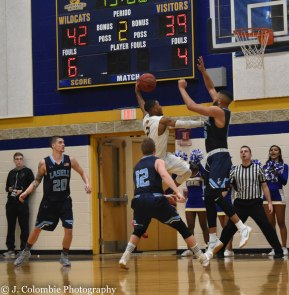 John Powell attempts to block a shot during the semifinal matchup. Powell finished with three blocks in the game. (Photo by Jackie Colombie)