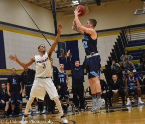 Sophomore guard Tim Blair puts up a shot during the team's semifinal game against the Johnson & Wales Wildcats. (Photo by Jackie Colombie)