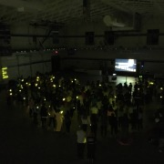 Attendees crack their glow sticks in unison to honor those that have lost the battle with cancer.