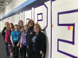 """Cancer survivors stand in front of the word """"Hope."""""""