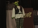 Spencer Koisor as Shrek practices the character's trademark roar on stage.