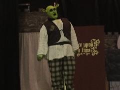 Spencer Koisor as Shrek practices the character's trademark roar on stage.