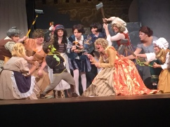 The villagers taunt young Shrek played by Curtis Keane (center).