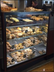 Einstein's restocks their bagel and pastry options regularly after the morning rush.