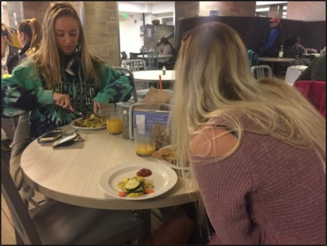 Jessica Pascucci (left) and Christina Green (right) sample the Saudi Arabian cuisine offered at lunch in Valentine Dining Hall.