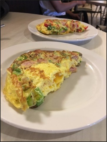 Chartwell employees put in a lot of time and detail when preparing omelettes in the Valentine Dining Hall.