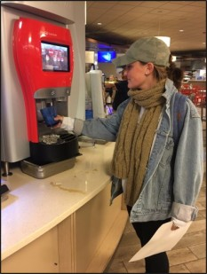 Elizabeth Savikas uses the touch screen fountain to get some Coca- Cola at the Valentine dining hall.