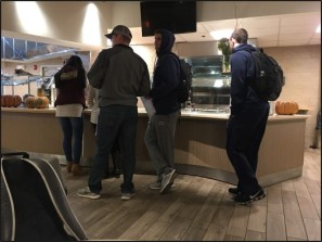 Students wait in line for tater tots at breakfast in Valentine Dining Hall.