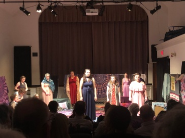 """Mrs. Peters looking for Mrs. Wright's bird in the show """"Trifles."""" (L) The cast of """"The Refugee Women"""" put on their own play titled, """"The Trojan Women."""" (R)"""