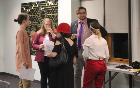 Students participate in the murder-mystery during the Mocktail Speakeasy event on the top floor of the Arnow Campus Center.